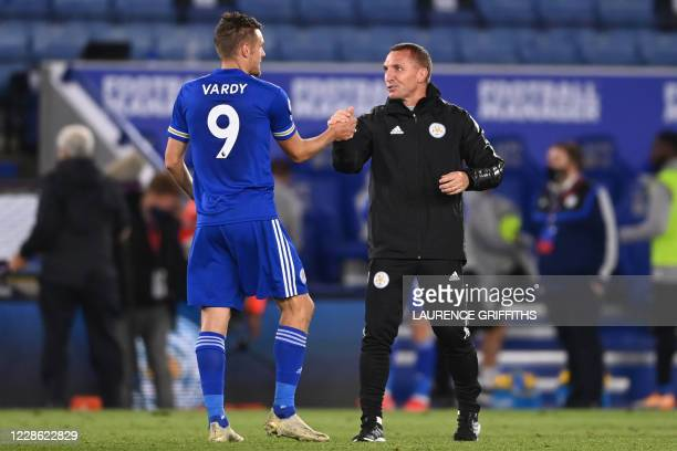 Leicester City's Northern Irish manager Brendan Rodgers celebrates with Leicester City's English striker Jamie Vardy after winning the English...