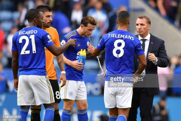 Leicester City's Northern Irish manager Brendan Rodgers congratulates his players after the English Premier League football match between Leicester...