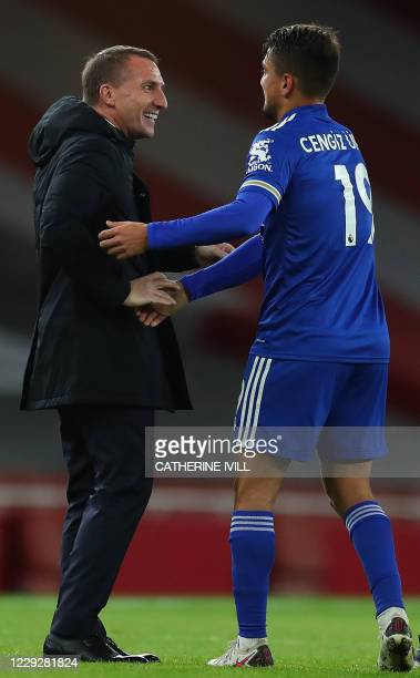 Leicester City's Northern Irish manager Brendan Rodgers congratulates Leicester City's Turkish striker Cengiz Underat the final whistle during the...