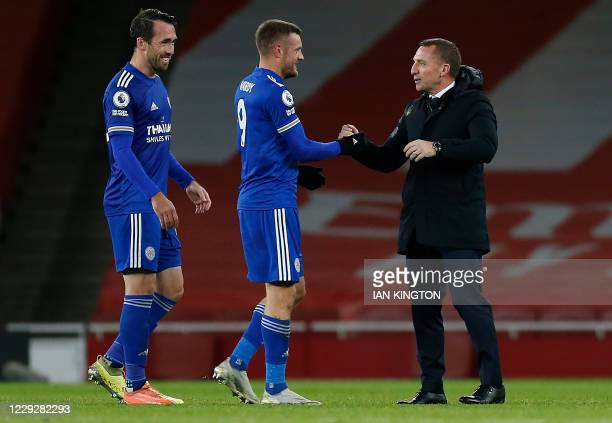 Leicester City's Northern Irish manager Brendan Rodgers congratulates Leicester City's English striker Jamie Vardy and Leicester City's Austrian...