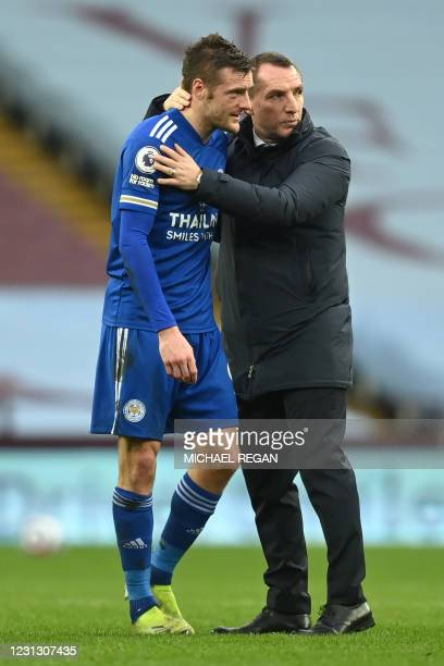 Leicester City's Northern Irish manager Brendan Rodgers congratulates Leicester City's English striker Jamie Vardy after the English Premier League...