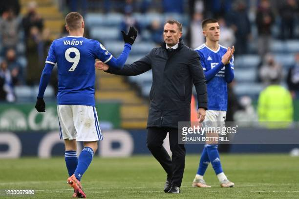 Leicester City's Northern Irish manager Brendan Rodgers greets Leicester City's English striker Jamie Vardy at the end of the English Premier League...