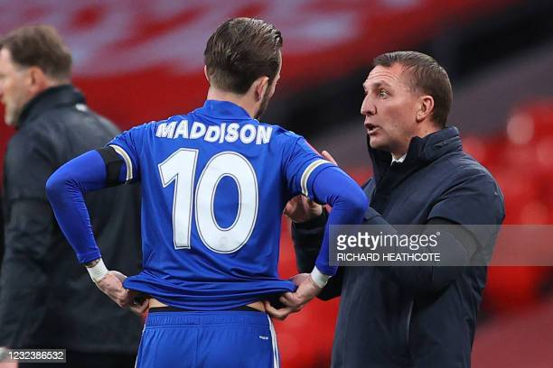 Leicester City's Northern Irish manager Brendan Rodgers speaks with Leicester City's English midfielder James Maddison during a break in play during...