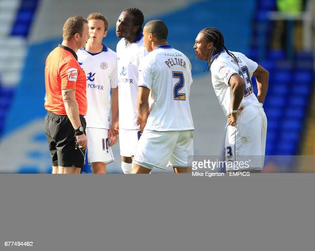 Leicester City's players surround referee Kevin Wright after he sends off Matt Mills