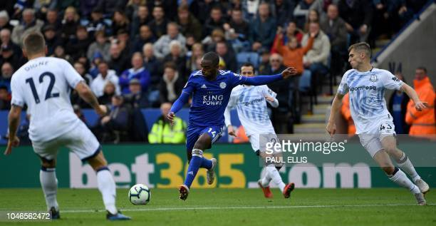 Leicester City's Portuguese defender Ricardo Pereira runs to score his team's first goal past Everton's English midfielder Jonjoe Kenny during the...
