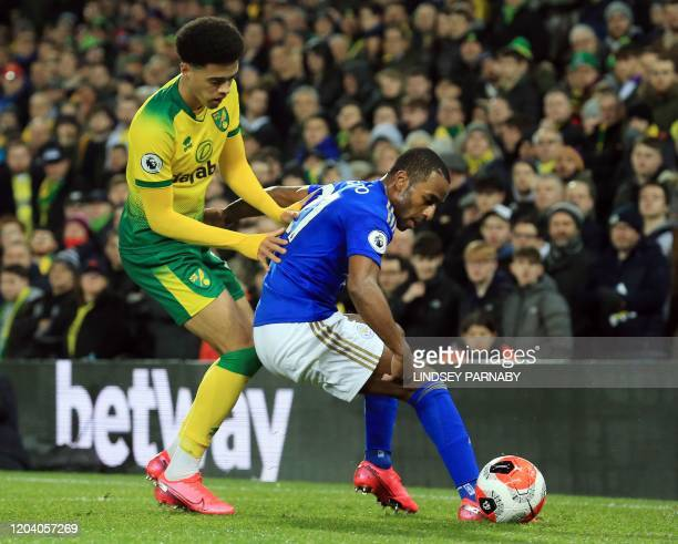 Leicester City's Portuguese defender Ricardo Pereira vies for the ball against Norwich City's English-born Northern Irish defender Jamal Lewis during...