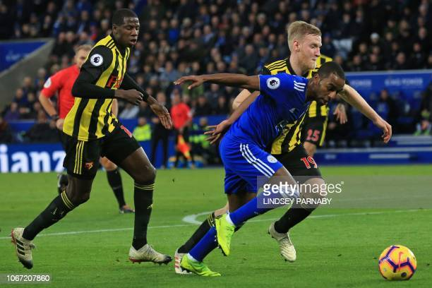 Leicester City's Portuguese defender Ricardo Pereira vies with Watford's English midfielder Will Hughes during the English Premier League football...