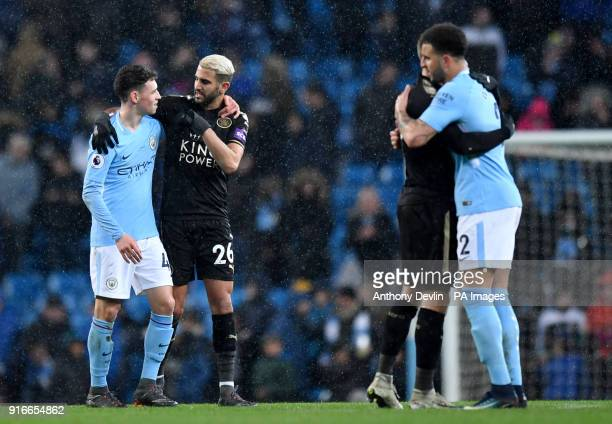 Leicester City's Riyad Mahrez and Manchester City's Phil Foden after the Premier League match at the Etihad Stadium Manchester