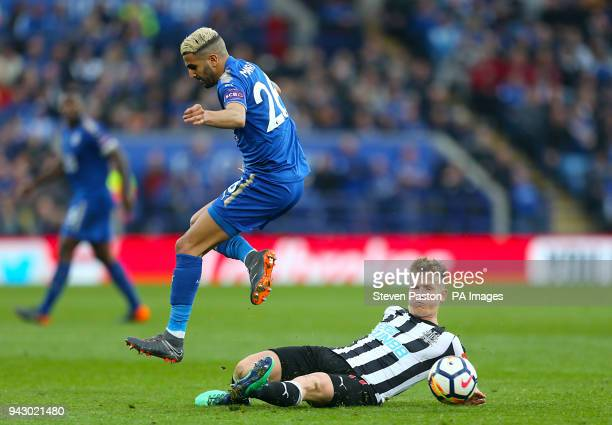 Leicester City's Riyad Mahrez and Newcastle United's Matt Ritchie battle for the ball during the Premier League match at the King Power Stadium...