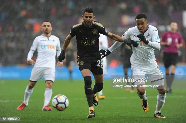 Leicester City's Riyad Mahrez battles with Swansea City's Martin Olsson during the Premier League match between Swansea City and Leicester City at...