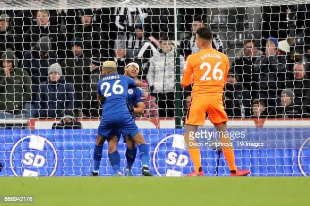 Leicester City's Riyad Mahrez celebrates Newcastle United's Ayoze Perez scoring an own goal during the Premier League match at St James' Park...
