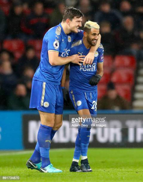 Leicester City's Riyad Mahrez celebrates scoring his side's first goal of the game with team mate Leicester City's Harry Maguire during the Premier...