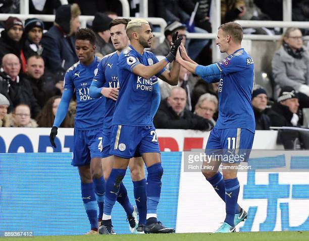 Leicester City's Riyad Mahrez celebrates with team mate Marc Albrighton after scoring his side's equalising goal to make the score 11 during the...