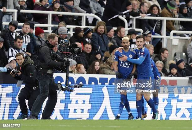Leicester City's Riyad Mahrez celebrates with team mates after scoring his side's equalising goal to make the score 11 during the Premier League...
