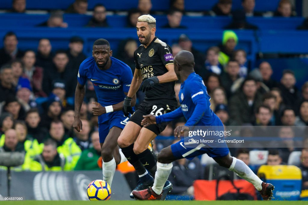 Leicester City's Riyad Mahrez evades the challenge of Chelsea's Ngolo Kante and Antonio Rudiger during the Premier League match between Chelsea and Leicester City at Stamford Bridge on January 13, 2018 in London, England.