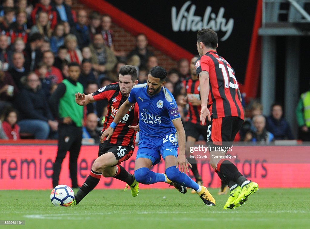 Leicester City's Riyad Mahrez is brought down by Bournemouth's Lewis Cook during the Premier League match between AFC Bournemouth and Leicester City at Vitality Stadium on September 30, 2017 in Bournemouth, England.