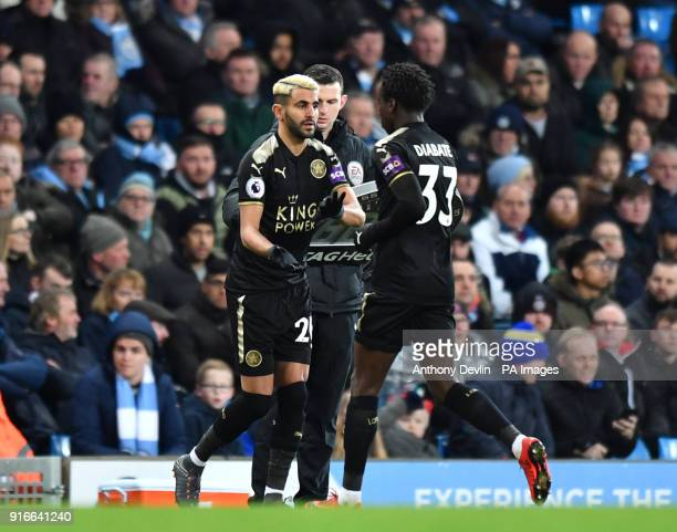 Leicester City's Riyad Mahrez is comes on from Fousseni Diabate during the Premier League match at the Etihad Stadium Manchester