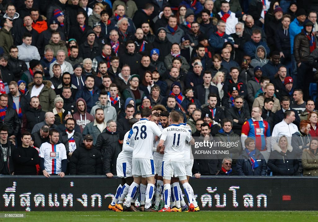 Leicester City's Riyad Mahrez (Centre Facing) is congratulated by team-mates after scoring his team's first goal during the English Premier League football match between Crystal Palace and Leicester City at Selhurst Park in south London on March 19, 2016. / AFP / ADRIAN DENNIS / RESTRICTED TO EDITORIAL USE. No use with unauthorized audio, video, data, fixture lists, club/league logos or 'live' services. Online in-match use limited to 75 images, no video emulation. No use in betting, games or single club/league/player publications. /