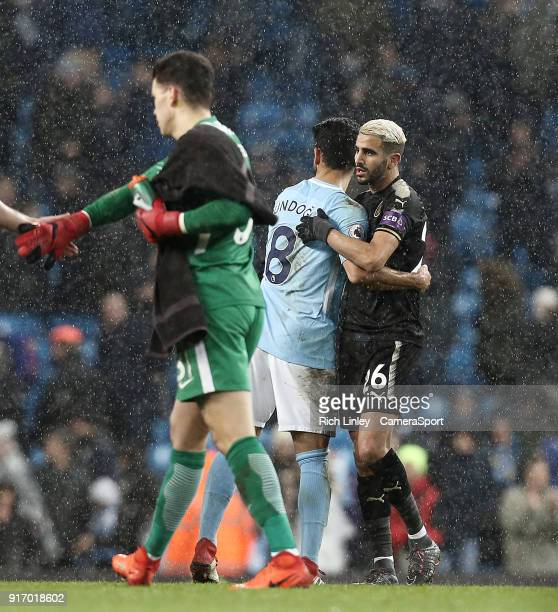 Leicester City's Riyad Mahrez is greeted by Manchester City's Ilkay Gundogan at the final whistle following the Premier League match between...