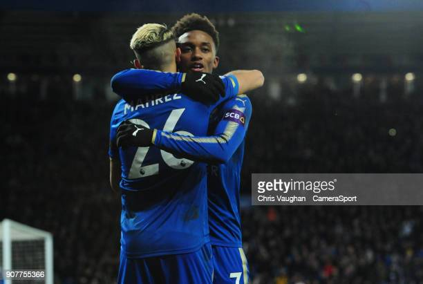 Leicester City's Riyad Mahrez left celebrates scoring his sides second goal with teammate Demarai Gray during the Premier League match between...