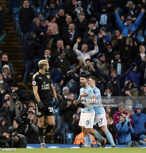 Leicester City's Riyad Mahrez looks on as Manchester City's Sergio Aguero celebrates with team mate Phil Foden after scoring his sides fifth goal...