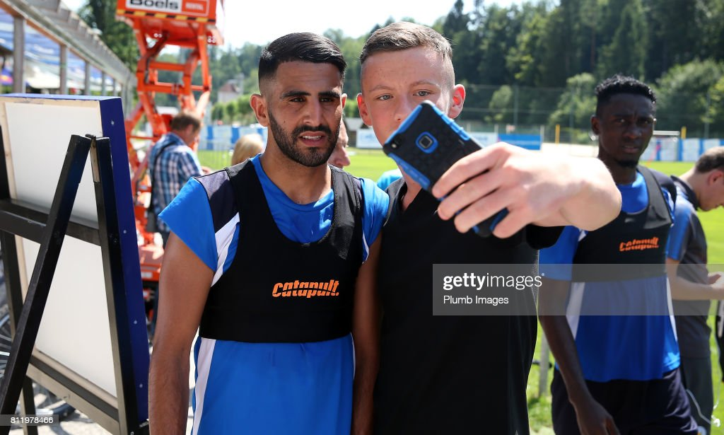 Leicester City's Riyad Mahrez poses with locals during the Leicester City Pre-Season tour of Austria at Velden Training Facility on July 10th , 2017 in Velden, Austria.