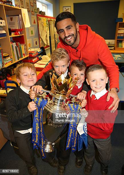 Leicester City's Riyad Mahrez suprises 4 young fans LR Archie Holm Liam Letts Leon Oscar Shakespeare and Alfie Marriott with a surprise visit with...