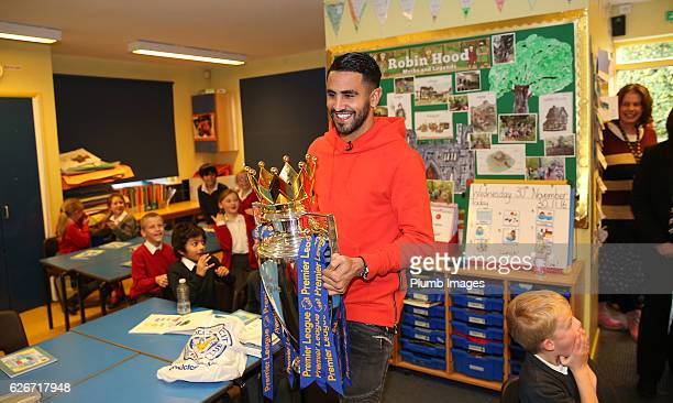 Leicester City's Riyad Mahrez suprises 4 young fans with a surprise visit with the Premier League Trophy after a video of the boys celebrating Mahrez...