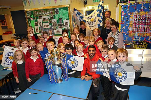 Leicester City's Riyad Mahrez suprises young fans with a surprise visit with the Premier League Trophy after a video of the boys celebrating Mahrez...
