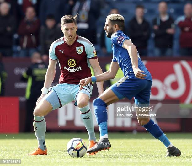 Leicester City's Riyad Mahrez under pressure from Burnley's Stephen Ward during the Premier League match between Burnley and Leicester City at Turf...