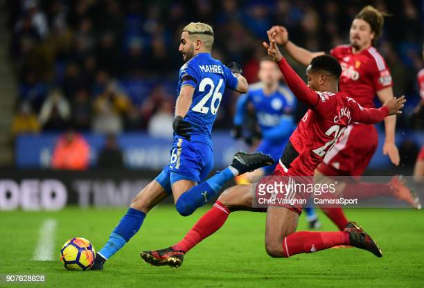 Leicester City's Riyad Mahrez under pressure from Watford's Andre Carrillo scores his sides second goal during the Premier League match between...