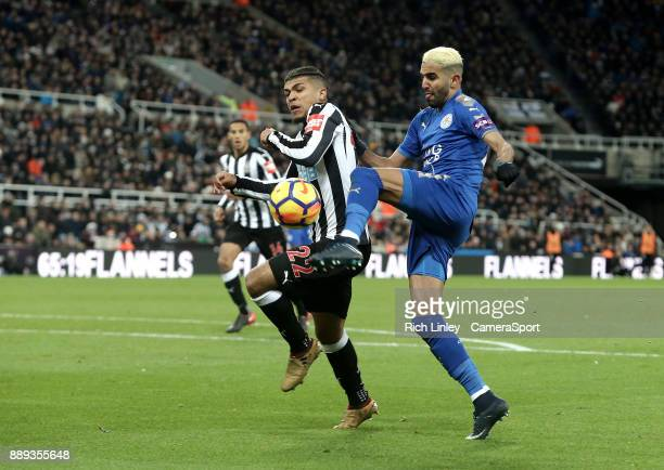 Leicester City's Riyad Mahrez vies for possession with Newcastle United's DeAndre Yedlin during the Premier League match between Newcastle United and...