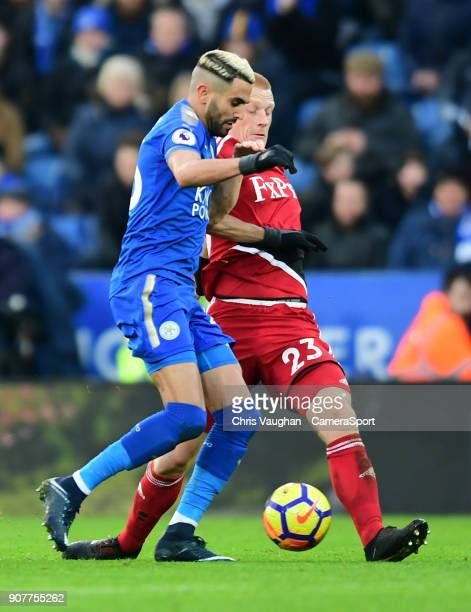 Leicester City's Riyad Mahrez vies for possession with Watford's Ben Watson during the Premier League match between Leicester City and Watford at The...