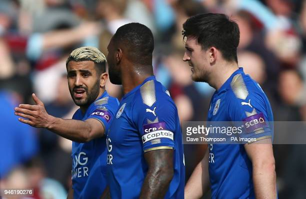 Leicester City's Riyad Mahrez Wes Morgan and Harry Maguire leave the pitch at half time during the Premier League match at Turf Moor Burnley