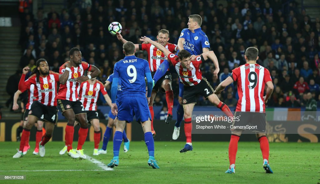 Leicester City's Robert Huth rises above Sunderland's Billy Jones to head towards goal during the Premier League match between Leicester City and Sunderland at The King Power Stadium on April 4, 2017 in Leicester, England.