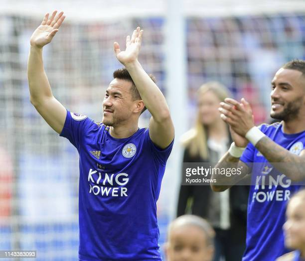 Leicester City's Shinji Okazaki acknowledges supporters after his last game for the Premier League club on May 12 against Chelsea in Leicester...