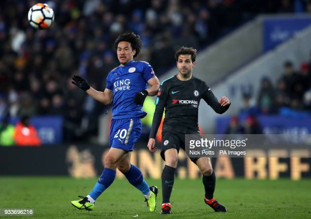 Leicester City's Shinji Okazaki and Chelsea's Cesc Fabregas during the Emirates FA Cup quarter final match at the King Power Stadium Leicester