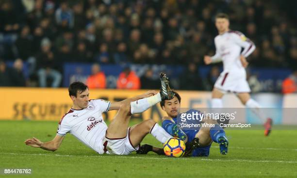 Leicester City's Shinji Okazaki battles with Burnley's Jack Cork during the Premier League match between Leicester City and Burnley at The King Power...