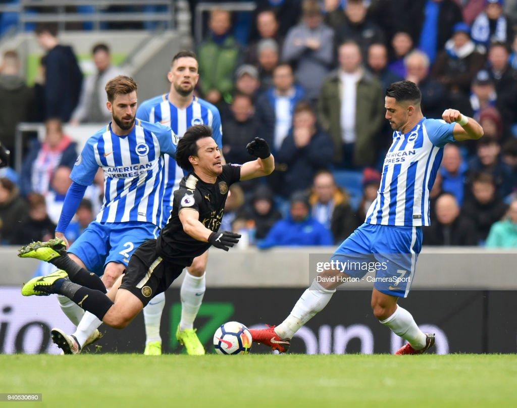 Leicester City's Shinji Okazaki & Brighton & Hove Albion's Beram Kayal during the Premier League match between Brighton and Hove Albion and Leicester City at Amex Stadium on March 31, 2018 in Brighton, England.