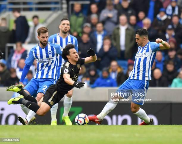 Leicester City's Shinji Okazaki Brighton Hove Albion's Beram Kayal during the Premier League match between Brighton and Hove Albion and Leicester...