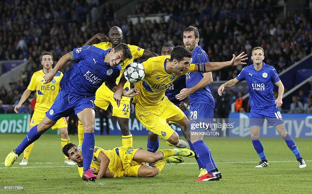 TOPSHOT - Leicester City's Spanish defender Luis Hernandez (L) vies with Porto's Spanish defender Ivan Marcano during the UEFA Champions League group G football match between Leicester City and Porto at the King Power Stadium in Leicester, central England on Septmeber 27, 2016.