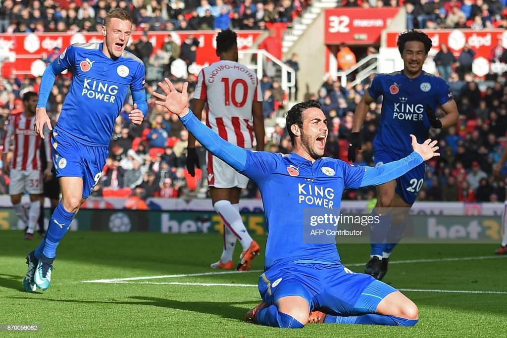 Leicester City's Spanish midfielder Vicente Iborra celebrates scoring the opening goal of the English Premier League football match between Stoke City and Leicester City at the Bet365 Stadium in Stoke-on-Trent, central England on November 4, 2017. / AFP PHOTO / Paul ELLIS / RESTRICTED TO EDITORIAL USE. No use with unauthorized audio, video, data, fixture lists, club/league logos or 'live' services. Online in-match use limited to 75 images, no video emulation. No use in betting, games or single club/league/player publications. /
