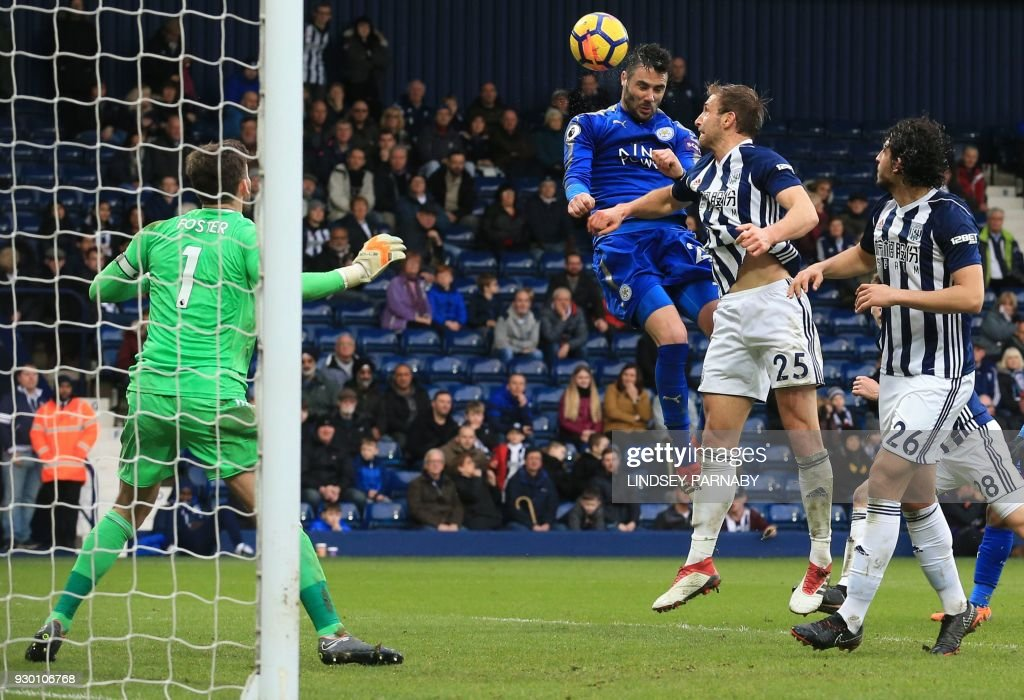 TOPSHOT - Leicester City's Spanish midfielder Vicente Iborra heads the ball to scores his team's fourth goal during the English Premier League football match between West Bromwich Albion and Leicester City at The Hawthorns stadium in West Bromwich, central England, on March 10, 2018. PHOTO / Lindsey PARNABY / RESTRICTED TO EDITORIAL USE. No use with unauthorized audio, video, data, fixture lists, club/league logos or 'live' services. Online in-match use limited to 75 images, no video emulation. No use in betting, games or single club/league/player publications. /
