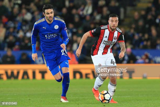 Leicester City's Spanish midfielder Vicente Iborra vies with Sheffield United's Irish midfielder Samir Carruthers during the English FA Cup fifth...