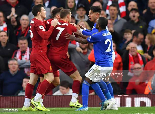 Leicester City's Spanish striker Ayoze Perez and Liverpool's Scottish defender Andrew Robertson scuffle at the final whistle during the English...