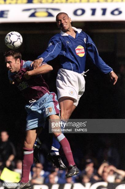 Leicester City's Stan Collymore beats Aston Villa's Gareth Southgate to a header