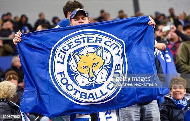 Leicester City's supporter holds his team's flag prior to the UEFA Champions League group G football match between FC Copenhagen and Leicester City...