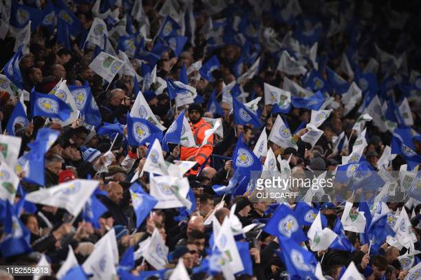 Leicester City's supporters wave flags before the English League Cup semifinal first leg football match between Leicester City and Aston Villa at...