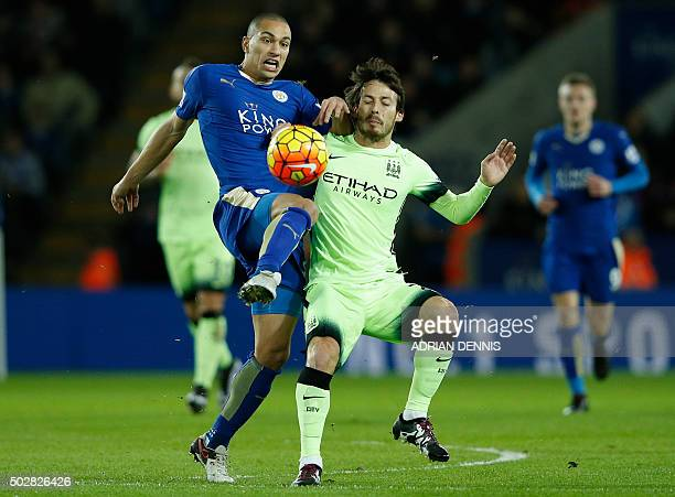 Leicester Citys Swiss midfielder Gokhan Inler vies with Manchester City's Spanish midfielder David Silva during the English Premier League football...
