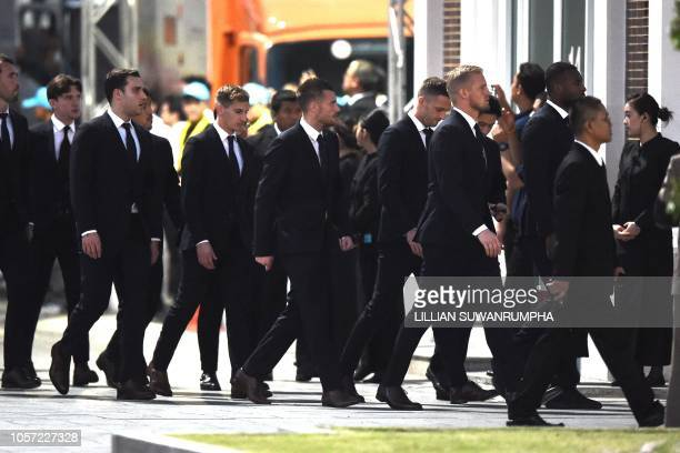 Leicester City's team captain Wes Morgan followed by goalkeeper Kasper Schmeichel with other team members and officials arrive at Wat Thepsirin...